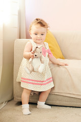 Cute little girl with bunny. little girl playing with toy rabbit