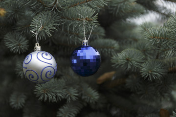 Silver and Blue Crystal balls on a Christmas tree.