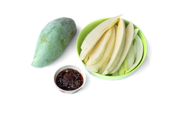 Green mangoes with sweet fish sauce isolated on white