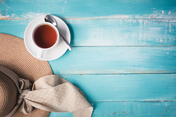 A cup of tea on a wooden table,top view copyspace concept