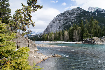 Mountain stream running across rocks and peak