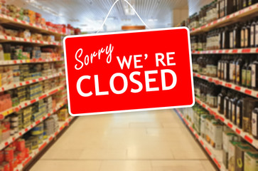 Sorry we are closed label on an abstract Supermarket background