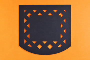 dark mexican perforated paper on orange background