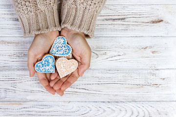 Hands hold cookies in form of heart