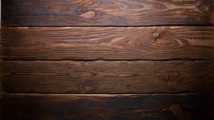 Brown wooden background. Top view. Free space for your text.