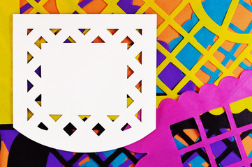 white mexican perforated paper on colorful background