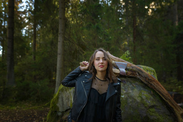 beautiful woman with ax in a forest