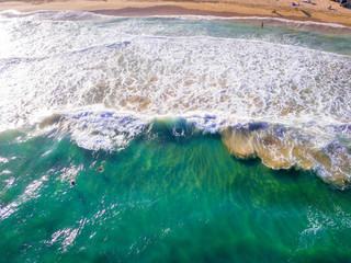 Amazing aerial view of the ocean waves from above on the island of Kauai, Hawaii