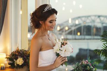 Young happy bride wearing beautiful lush dress