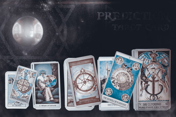 Tarot card / View of tarot card on old leather with crystal ball. The Wheel of fortune.