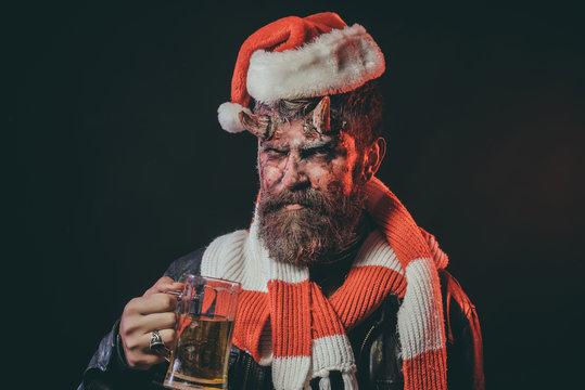 Halloween christmas hipster with satan horns hold glass mug