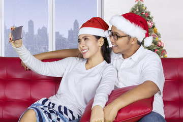 Asian couple taking photo in the apartment