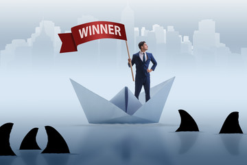 Businessman riding paper boat ship in winning concept