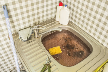 The clogged kitchen sink. Clogged pipes. Problems with the water supply.