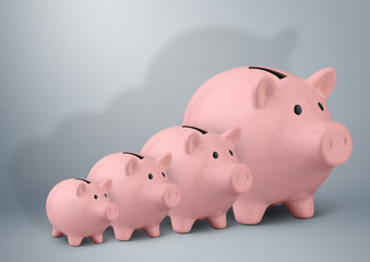 Piggy banks of different sizes, savings growth concept