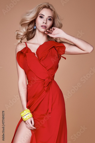 d02fbfc7af43 Beautiful sexy young business woman blond hair with evening makeup wearing  long red silk dress high heels shoes fashion clothes for meetings and walks  date ...