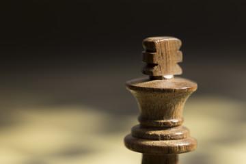 A white king chess piece