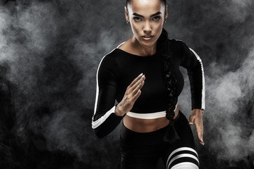 A strong athletic, woman sprinter, run. Girl wearing in the sportswear, fitness and sport motivation concept with copy space.