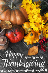 Thanksgiving day concept - traditional holiday food with pumpkins on old wooden. space for text