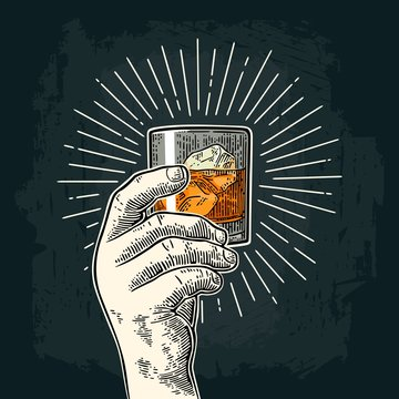 Male hand holding glass whiskey with ray