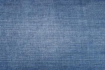 Close up shot of blue worn denim jeans fabric