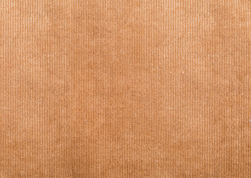Close up shot of brown worn cord fabric