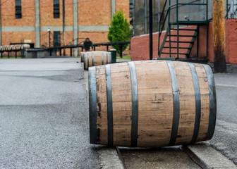 Wall Mural - Bourbon Barrels Rolling Down Metal Track