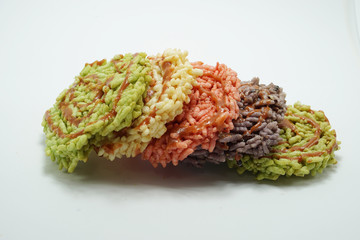 Multicolor rice cracker made from herbal coloring.  Rice cracker (Thai cuisine) isolated on white background.