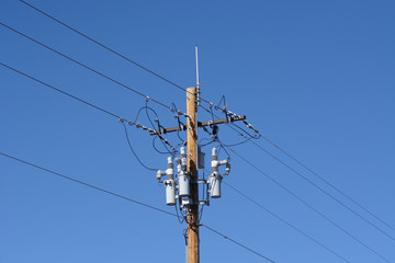 Electric power lines with power circuit breakers and antenna on new wooden pole