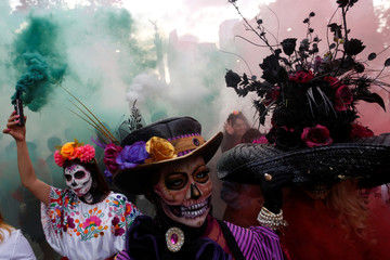 "Women dressed up as ""Catrina"", a Mexican character also known as ""The Elegant Death"", takes part in a Catrinas parade in Mexico City, Mexico"