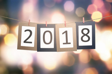 2018 number on paperboard for New Year hanging on rope