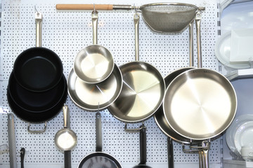 Several empty  frying pans