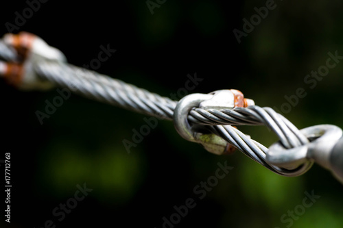 A close up of heavy duty steel wire cable connector. Coils of wire ...