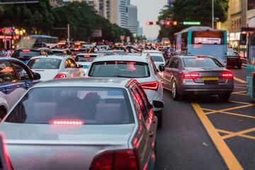 traffic jam on main street with row of cars