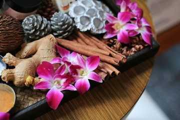 Orchid flower on wooden tray, Health care and spa concept. Nature spa ingredient.