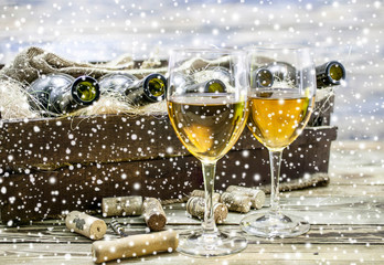 Two white wine  glasses.  New Year celebration background.