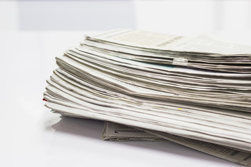 Closeup - many news paper on white background