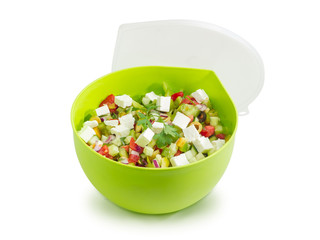Greek salad in round green food container