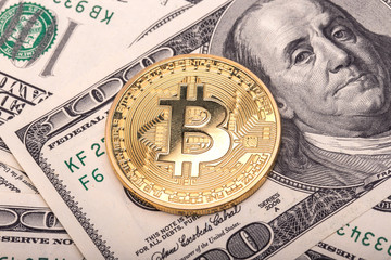Golden Bitcoins on US dollars.