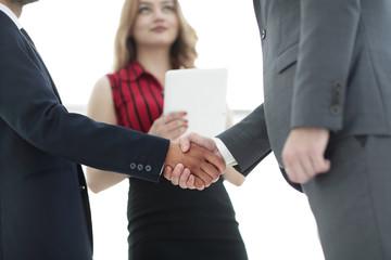 Businessmen handshaking after good deal. Business concept