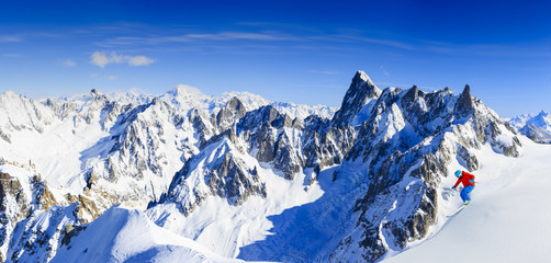 Skiing Vallee Blanche Chamonix with amazing panorama of Grandes Jorasses and Dent du Geant from Aiguille du Midi, Mont Blanc mountain, Haute-Savoie, France
