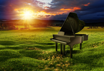 Piano on the meadow under the dramatic sky