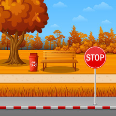 Autumn park with stop sign on town roadside and bench