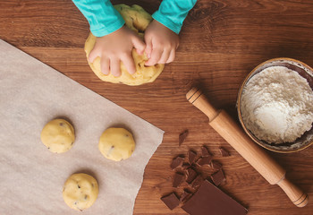 A child makes a cookie. Selective focus.