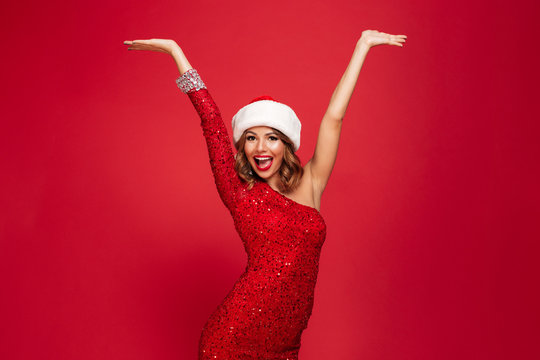 Portrait of an excited smiling woman in christmas hat