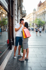 Couple are kissing in shopping