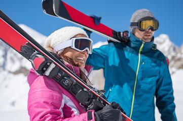 Couple holding ski
