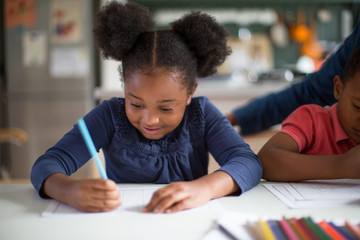 African American girl doing school work at home