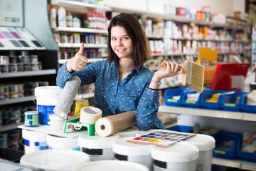 Glad girl demonstrating tools for renovating