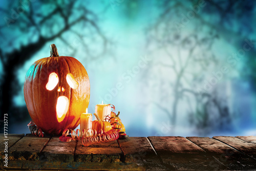 Pumpkin with candles on halloween background